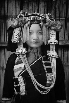 Laos, Phongsali Province, Huay Yueng Village, Akha hill tribe, lady with traditional headdress. © Glen Allison