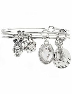 Our trio of bangle bracelets is a whimsical addition to your collection with owl, wishbone and rhinestone charms. #LaneBryant
