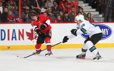 San Jose Sharks defenseman Matt Irwin reaches out to block a shot by Kyle Turris of the Ottawa Senators (Oct. 27, 2013).