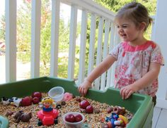 autumn themed sensory tub = filled with dried wild rice, popcorn, lentils, fake apples and acorns.