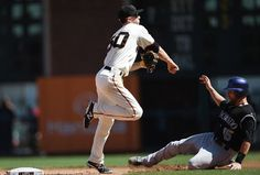 SAN FRANCISCO, CA - AUGUST 28: Matt Duffy #50 of the San Francisco Giants gets his throw off over the top of Jackson Williams #15 of the Colorado Rockies but not in time to complete the double-play in the top of the eighth inning at AT&T Park on August 28, 2014 in San Francisco, California. (Photo by Thearon W. Henderson/Getty Images)