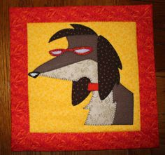 Silly dog quilted applique wall hanging. Dog quilt.