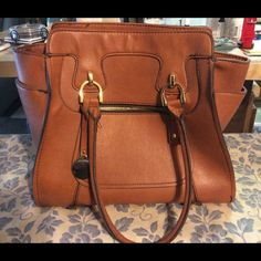 LONDON FOG tan handbag This bag is brand new. No wear and tear. Worn once no stains, marks, or scratches London Fog Bags Totes
