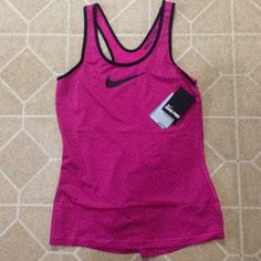 Nike Pro Tank A hot pink and black polka dot Nike Pro Racerback Tank. Dri fit and Stay Cool material Nike Tops Tank Tops
