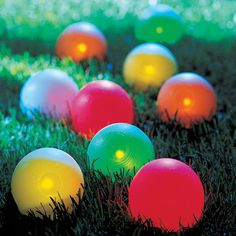 This illuminated bocce ball set lets you play in the dark. Each of the eight balls has an LE...