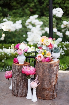 Do you like the natural feeling or the logs used as pedestals? (You could use them to set candles on, lanterns on, or flowers)