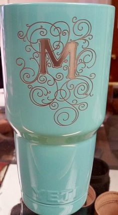http://www.phomz.com/category/Yeti-Tumbler/ Tiffany blue, powder coated and laser etched Yeti.