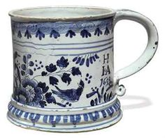 A LONDON DELFT DATED BLUE AND WHITE MUG