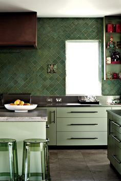 Love the wall 'o tile. Not so sure about the cabinet colors, though.