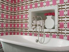 Patterned raspberry wallpaper adds unexpected color in this retro-inspired bathroom. (http://www.hgtv.com/bathrooms/our-favorite-bright-bold-bathrooms/pictures/index.html?soc=Pinterest)