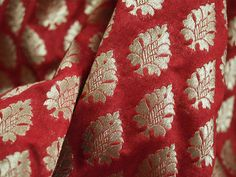 This is a beautiful pure benarse silk brocade floral motifs design fabric in Maroon and Gold. The fabric illustrate small golden woven motifs on Maroon background.  You can use this fabric to...