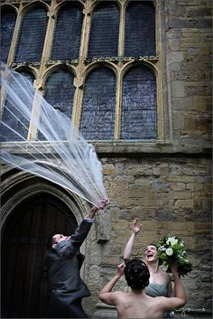 nealejames.com | wedding photography - from today's wedding, the wind threatened to spoil the party for one moment. Fortunately the usher can leap!