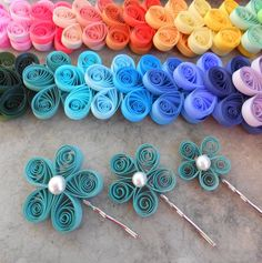 """""""These lovely paper flower hair pieces are great for weddings! This listing is for 3 quilled paper flowers, in the colors or papers of your choice! Each will have a pearl in the middle and be on a silver bobby pin. They are very lightweight and can go anywhere within your hairstyle! The flowers are three different sizes. From 1\"""" to 2\"""". They look great in any bride's hairstyle! These make great gifts for bridesmaids too. AT CHECKOUT: PLEASE LET ME KNOW WHAT COLORS YOU WOULD LIKE. I CAN DO THREE Paper Quilling Earrings, Paper Quilling Flowers, Paper Quilling Cards, Paper Quilling Patterns, Origami And Quilling, Quilled Paper Art, Quilling Jewelry, Quilling Art, Quilling Ideas"""