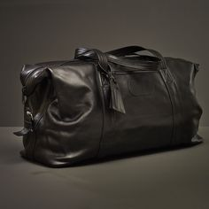 Made of the luxurious strong black leather this duffle bag is a stylish accessory of envy for travel enthusiasts or even for those who need lots of room for their gym kit.  The soft leather and structure makes it very flexible to fold when it is empty and light to carry.