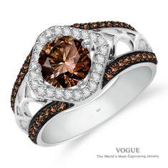 Striking Coco Round Center Diamond Ring with White Diamond Accents set in 14k White Gold.