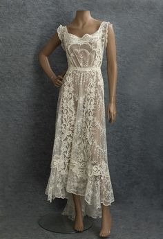 Circa 1910 Mixed Lace Wedding Dress, made from delicate embroidered net lace with bold accents of textured Quipure flowers.