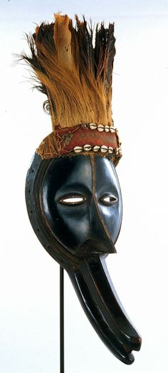 "Côte d'Ivoire; Diomande peoples Gegon (mask) Wood, cloth, shell, metal, feathers H. 64.1 cm. (25"") The University of Iowa Museum of Art, The..."