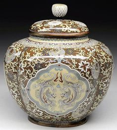 """CLOISONNE GOLDDUST JAR WITH COVER. Meiji Period (1868-1912), Japan. Oval form with a lobated body. Decoration of phoenixes and dragons on a floral scrolled goldstone brown. SIZE: 5-1/2"""" h x 5"""" l. PROVENANCE: From a private New York State collection."""