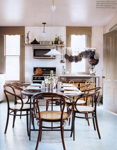 LOVE!  Domino Mag Files:  love the trim color┃tile floor┃table┃bentwood chairs┃long windows