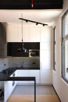 Spanish architects META Studio build stunning loft home from an old textile factory Modern Black Kitchen, Home, Studio Kitchen, House Design, Loft House, Studio Build, Industrial Loft, Kitchen Interior, Pent House