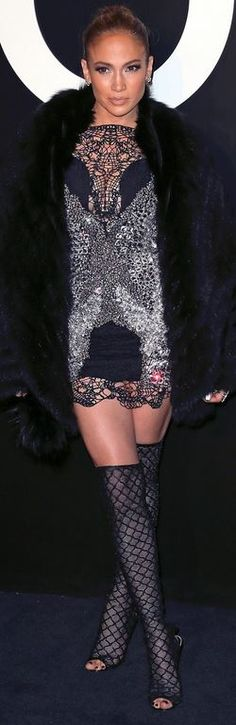 Who made  Jennifer Lopez's black boots and silver dress  fashion style id