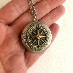 Steampunk Compass Locket Necklace, mixed metal silver gold brass... ($28) ❤ liked on Polyvore featuring jewelry, gold jewelry, graduation jewelry, silver locket, steampunk jewelry and engraved jewelry
