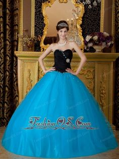 Exquisite Teal Quinceanera Dress Sweetheart Beading Tulle Ball Gown    http://www.facebook.com/quinceaneradress.fashionos.us  www.fashionos.com  This dress is so gorgeous, it would even make Cinderella jealous! It features a beautiful strapless ruched bodice with a sweetheart neckline and a special beading desigh from one bust trim extend to waist part. The A-line skirt is full and shapely, made from many sheer layers of beautiful organza. Colorful beading dotted on the puffy skirt.