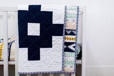 This navy blue aztec quilt with the Arizona Fabric Arid Horizon on the back is the perfect modern accent for your nursery or home. Measures at a generous