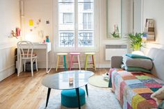 Lili and Dwayne share this colorful and cozy Paris apartment; it's just under 450 square feet.