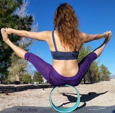 double toe to hand balance while sitting on dharma yoga wheel.