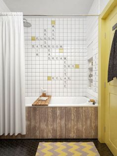 Custom Wall Tile In The Bath   Scrabble. Wood Planks On The Exterior Of The  Tub.