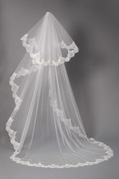 Epitomizing pure romance and desire, the CONSTANCE veil will enhance any bridal silhouette with grace and eternal charm. Appliqué lace detailing accents the scalloped edging, which combined with the lustrous layers, offers an unrivalled luxurious aesthetic.Open Length Comb to finished length320cm 250cmTwo tier veil With corded lace edging