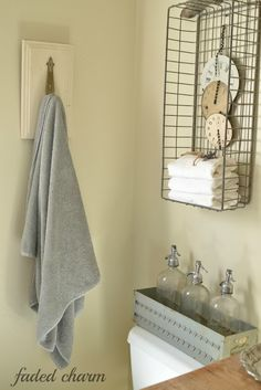 FRENCH COUNTRY COTTAGE: repurposed bathroom shelf...Love the color of blue? and the basket on wall ..great small bath idea!!