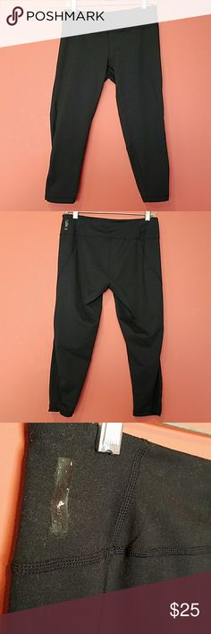 Zella capri workout pants Name brand:  Zella.  Width (waist): 14.5 inches. Length:  28.5 inches. Inseam:  21.5 inches.  Size: Medium.   Used.  The outer logo was taken off the pants (as seen in pic).  The bottom of the sides are the see through design.  Small hidden pocket.   Logo/size tag inside hidden pocket.  Black Zella Pants Capris