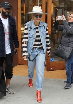 Earning her fashion stripes! Rita Ora showed off her punk rock inspired style with a jean vest when she shopped at David Yurman in Beverly Hills on Tuesday Metallic Boots, Satin Jumpsuit, Punk Rock Fashion, Jean Vest, Double Denim, Denim Trends, Rita Ora, Rock Style, Mom Jeans