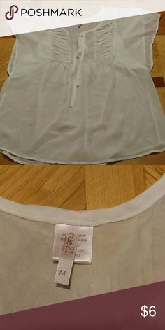 Rue 21 sheer shirt Rue 21 sheer shirt. Cream color. Loose fitting. Womens size medium. Excellent condition. Smoke free home. Rue 21 Tops Blouses