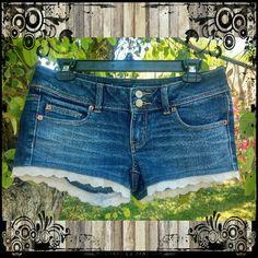 American Eagle Ruffle Trim Shorts Size 4 American Eagle ruffle trim short shorts. Great used condition, so cute!!  #aeo #americaneagle #aeoshorts #ruffleshorts #daisydukes #shortshorts #jeanshorts #denimshorts American Eagle Outfitters Shorts Jean Shorts