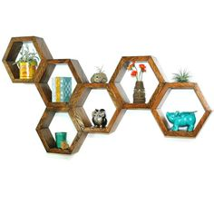 Reclaimed wood floating hexagon shelves hand-crafted from vintage utility pole salvage. Only the finest Douglas Fir timber is used in the
