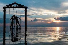 I captured this shot of a loving couple kissing on the iconic swing in Lombok Indonesia. With the sunset in the background their silhouette hanging against the pastel skies really brought out a sort of cinematic feel. By intentionally underexposing this shot it brought out the colours of the golden hour. Image captured by Azrul Aziz @azrulazizphotography on Instagram. Shot on the EOS 6D with the EF 50mm f/1.4 USM at ISO 100 f/4 1/800. #canonasia via Canon on Instagram - #photographer…