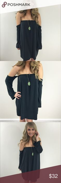 Off the shoulder dress This off the shoulder dress is simple and stylish. This dress features an elasticized Off-the-shoulder  collar, long sleeves and a slightly flared silhouette.                                                      75% rayon 25% polyester - wearing size small Dresses Mini