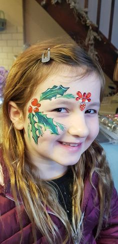Christmas Face Painting, holly berries, girls facepaint, red, green, bling, gems Christmas Face Painting, Holly Berries, Festival Looks, Red Green, Gems, Bling, Festival Style, Jewel, Gemstones