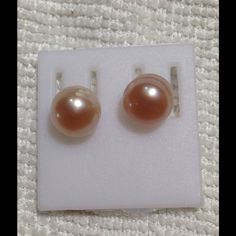 Pink pearl stud earrings The pearls are pink natural freshwater pearls. The posts are flexible and the backs are plastic. Since these are natural items, each one looks a little different in appearance. These are varying shades of pink and purple Jewelry Earrings