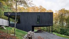7 gorgeous black timber homes to swoon over - - Shou Sugi Ban and other similar techniques add a dark and unexpected dimension to otherwise simple, minimalist architectural designs. Architecture Résidentielle, Scandinavian Architecture, Minimalist Architecture, Scandinavian Cabin, Casa Do Rock, Rock Rock, Haus Am Hang, Clad Home, Hillside House