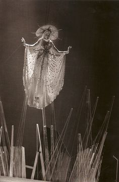 'La Madone' ('The Madonna') Halo headdress in embroidered tulle by Steven Jones. Celebration of Thierry Mugler's first ten years in the fashion industry at Le Zénith, Paris: The first and only runway show open to the public. Thierry MuglerPrêt-à-Porter CollectionAutumn/Winter 1984-85Photo by Françoise Huguier