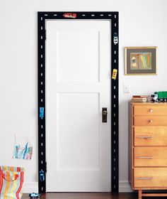 Racetrack doorway using velcro. Cute idea! Think I will create a track on the wall for my little boys so they can reach.