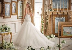 Wedding Dresses and Bridal Gowns by Morilee designed by Madeline Gardner. Beautiful crystal beads glisten the amazing design of this flowing wedding dress.
