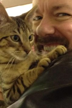 Ricky Gervais cheating on his cat, Ollie