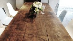 Rustic A Frame dining table made from reclaimed timber. Handmade in England. Bespoke for your space.
