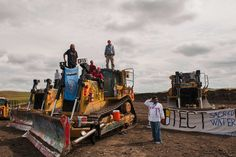 Protesters stood on heavy machinery on Tuesday after halting work on the Dakota Access oil pipeline near the Standing Rock Sioux Tribe's reservation near Cannon Ball, N. (via The New York Times) North Dakota, North America, New York Times, Dakota Do Norte, Illinois, Dakota Pipeline, Pipeline Project, Dakota Access, Army Corps Of Engineers