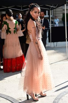 6 July Zoe Kravitz arrived for the Valentino show in Paris in a beautiful nude, tulle dress.   - HarpersBAZAAR.co.uk